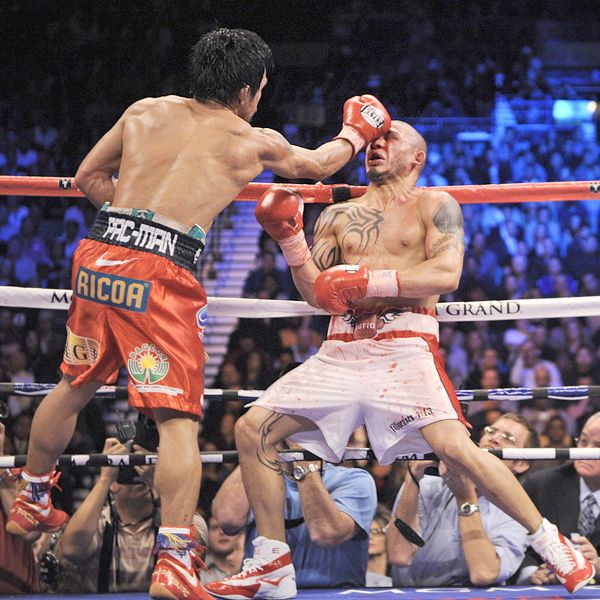 Manny Pacquiao defeats Miguel Cotto (AP Photo by Mark J. Terrill)